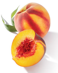 Whole and halved peach