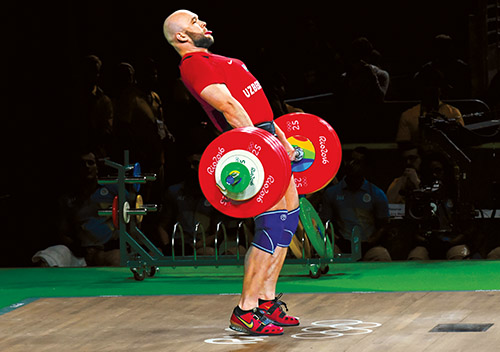 Uzbekistan's Ruslan Nurudinov competes during the Men's 105kg weightlifting competition at the Rio 2016 Olympic Games in Rio de Janeiro on August 15, 2016. / AFP / GOH Chai Hin (Photo credit should read GOH CHAI HIN/AFP/Getty Images)