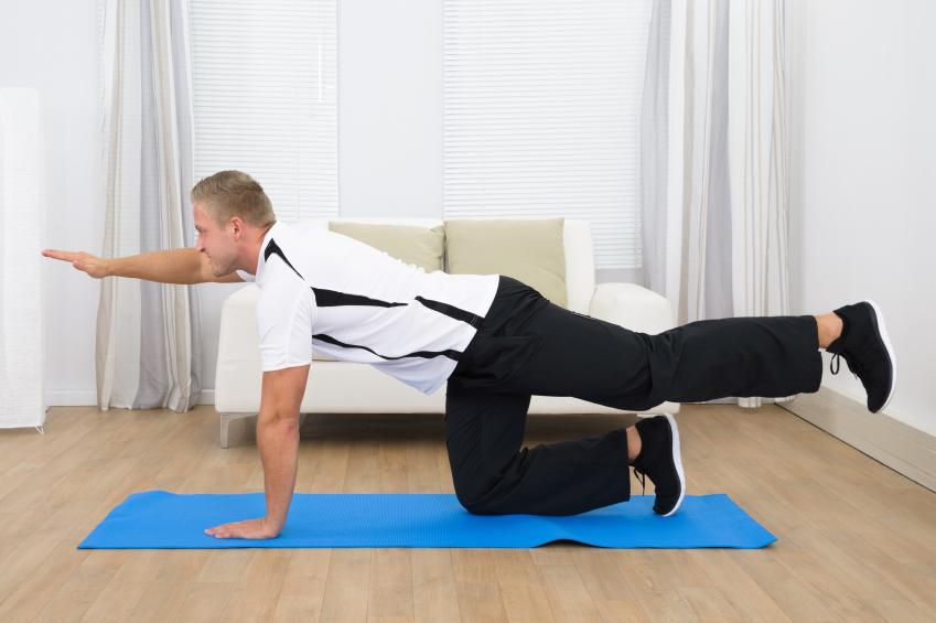 Healthy Sporty Young Man Exercising On Mat At Home